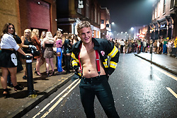 © Licensed to London News Pictures . 26/12/2018. Wigan, UK. A man dressed as a fireman on King Street . Revellers in Wigan enjoy Boxing Day drinks and clubbing in Wigan Wallgate . In recent years a tradition has been established in which people go out wearing fancy-dress costumes on Boxing Day night . Photo credit: Joel Goodman/LNP