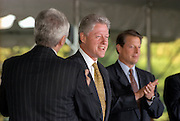 US President Bill Clinton is applauded by Brian O'Dwyer and Vice-President Al Gore during a ceremony on the South Lawn of the White House September 11, 1998 in Washington, DC. Clinton received the Paul O'Dwyer Peace and Justice Award, for Clinton's work in helping bring peace in Northern Ireland. The ceremony took place the same day the Starr Report was released to Congress.