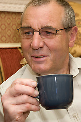 Portrait of an older man drinking a cup of tea,