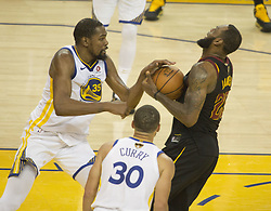 May 31, 2018 - Oakland, California, U.S - LeBron James #23 of the Cleveland  Cavaliers is blocked by   Kevin Durant #35 of the Golden State Warriors during their  NBA Championship Game 1 at Oracle Arena in Oakland,  California on Thursday,  May 31, 2018. ARMANDO  ARORIZO/PI (Credit Image: © Prensa Internacional via ZUMA Wire)
