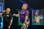 Peter Wright reacts during the PDC Premier League Darts Night 11 at Marshall Arena, Milton Keynes, United Kingdom on 6 May 2021.
