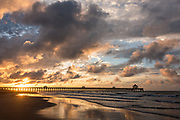 Dawn breaks over the Folly Beach Pier on a cloudy morning June 5, 2017 in Folly Beach, South Carolina. Folly Beach is a quirky beach community outside Charleston known to locals as the Edge of America.
