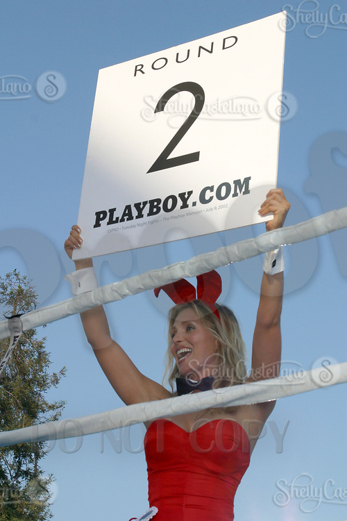 Jul 09, 2002; Los Angeles, CA, USA; Playboy bunny shows the 4th round card @ Sugar Ray Leonard's Tuesday Night Fights on ESPN2 live from the Playboy Mansion.<br />Mandatory Credit: Photo by Shelly Castellano/ZUMA Press.<br />(©) Copyright 2002 by Shelly Castellano