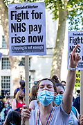 Nurses as well as care workers from St Thomas' Hospital, wearing face protective surgical masks to curb the spread of coronavirus pandemic, hold placards as they protest in front of Downing Street for a pay rise in London, Wednesday, July 29, 2020. Health care unions are launching a campaign for a pay rise for NHS (National Health Service) nurses and care workers. NHS demonstration was also supported by the Black Lives Matter activists. (VXP Photo/ Vudi Xhymshiti)