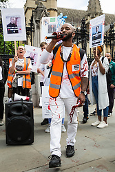 London, UK. 26 June, 2019. Campaigners against knife crime, including families who have lost loved ones to knife crime, protest with fake blood outside Parliament as part of Operation Shutdown to put pressure on the Government, and in particular the next Prime Minister, to take urgent action to prevent knife crime and to protect its citizens. Credit: Mark Kerrison/Alamy Live News
