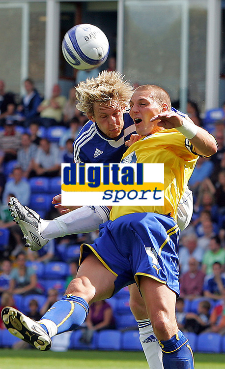 Peterboro Utd FC vs Sheffield Wednesday FC Championship 15/08/09<br /> Photo Nicky Hayes/Fotosports International<br /> Aerial action from Poshs' Craig Mackail-Smith and Darren Purse of Sheff Weds.