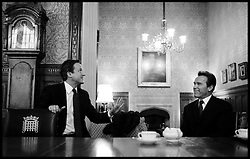 The Prime Minister David cameron meets Arnold Schwarzenegger in his office in the House of Commons   Wednesday March 30, 2011. Photo By Andrew Parsons / i-Images.