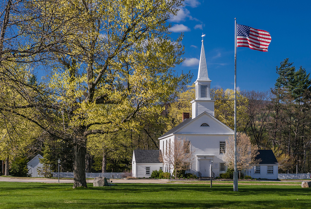 Village green with church American Flag, Sugar Maples with spring greens, Hebron, NH