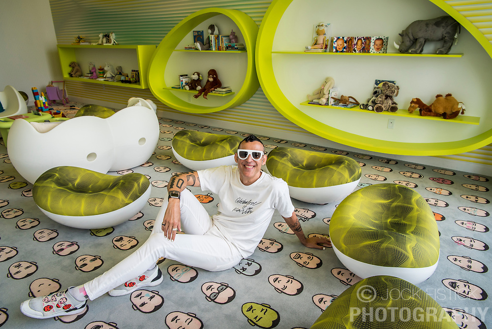 """Karim Rashid designed the interior spaces at Paraiso Bayviews, including the children's play room, where the carpet and his shoes bare his likeness. Time magazine described him as the """"most famous industrial designer in all the Americas"""" and the """"Prince of Plastic""""."""