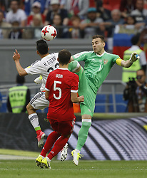 June 24, 2017 - Kazan, Russia - Hirving Lozano (L) of Mexico national team heads the ball to score as Igor Akinfeev (R) of Russia national team defends during the Group A - FIFA Confederations Cup Russia 2017 match between Russia and Mexico at Kazan Arena on June 24, 2017 in Kazan, Russia. (Credit Image: © Mike Kireev/NurPhoto via ZUMA Press)