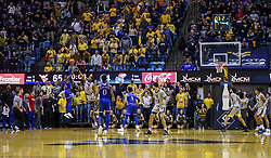 Jan 19, 2019; Morgantown, WV, USA; Kansas Jayhawks guard Lagerald Vick (24) shoots a final second three pointer from the corner against the West Virginia Mountaineers at WVU Coliseum. Mandatory Credit: Ben Queen-USA TODAY Sports