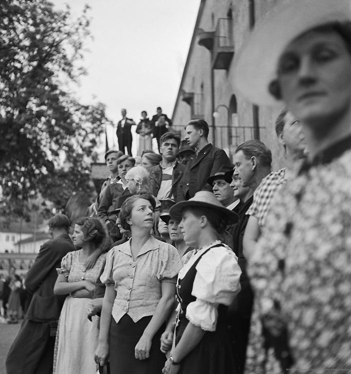 Crowds in front of theater, Salzburg, Austria, 1937