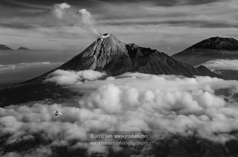 Mt. Merapi, DI Jogja, Jawa Tengah, Indonesia. Pilot Mas Arif of Jogja Flying Club in his Cosmos 582 Trike.