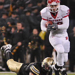 Oct 23, 2009; West Point, N.Y., USA; Rutgers running back Joe Martinek (38) evades tacklers during Rutgers' 27 - 10 victory over Army at Michie Stadium.