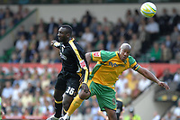 Photo: Ashley Pickering.<br /> Norwich City v Cardiff City. Coca Cola Championship. 01/09/2007.<br /> Jimmy-Floyd Hasselbaink of Cardiff (L) challenges Dion Dublin of Norwich in the air