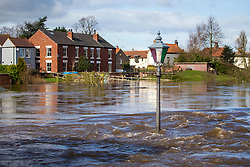 © Licensed to London News Pictures. 18/03/2019. Cawood UK. The river Ouse has broken it banks this morning in the village of Cawood near Selby in Yorkshire after recent heavy rainfall. Photo credit: Andrew McCaren/LNP