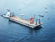 """ackroyd C06438-7. """"City of Portland. Knappton Corporation. Aerials – Portlandia. October 6, 1985"""" (statue on barge, being brought to crane in Waterfront Park)"""