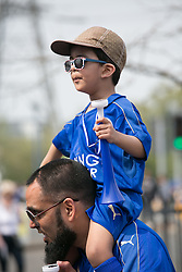 © Licensed to London News Pictures. 07/05/2016. Leicester, UK. Leicester City fans celebrating outside the King Power stadium before their match with Everton before lifting the Premiership trophy. Pictured, a young fan gets a better view. Photo credit: Dave Warren/LNP