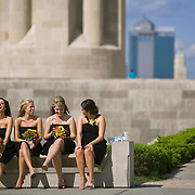 Waiting their turn for official wedding photographs to be taken Friday afternoon at the Liberty Memorial, bridesmaids (from left to right) Jamie Neeck, Bekah Allen, Ashley Jennings and Hana Harb gave their sore feet a rest on a bench while bride and groom Julia and Spencer Hilt were having their portrait taken.
