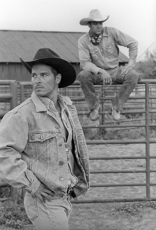 handsome cowboys outdoors looking in different directions