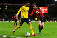 Joe Willock (28) of Arsenal battles for possession with Jack Simpson (25) of AFC Bournemouth during the The FA Cup match between Bournemouth and Arsenal at the Vitality Stadium, Bournemouth, England on 27 January 2020.