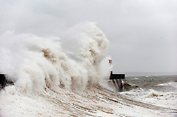© Licensed to London News Pictures. 15/11/2015. Porthcawl, Bridgend, Wales, UK. Huge waves crash against Porthcawl harbour wall. Gale force winds and large waves continue to batter the south coast of Wales. Photo credit: Graham M. Lawrence/LNP