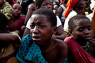 Children cry at Gabriel Makana's funeral after he was ambushed by the LRA and his body mutilated.  Makana was a popular employee in the ministry of education bringing schools to the region.