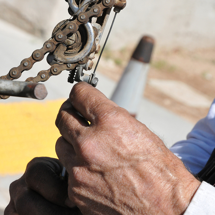 Guido, proprietor of Guido's Guerrilla Bikes, tightens a rear derailleur cable at the Spring 2012 Bicycle Swap Meet in Tucson, Arizona. Bike-tography by Martha Retallick.