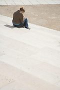 girl sitting alone on the steps