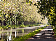 A tree lined canal in the Dordogne region of France