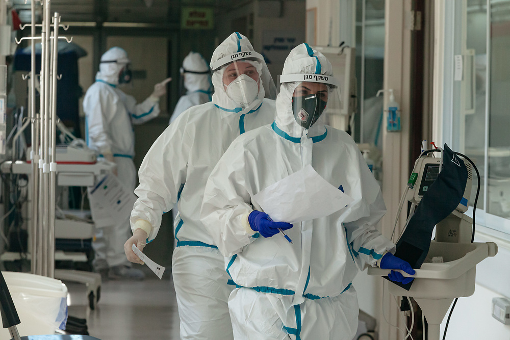 Nurses wearing protective gear are seen inside an isolated ward for Covid-19 Novel Coronavirus patients, at the Hadassah Ein Kerem Hospital, in Jerusalem, Israel, on April 20, 2020.