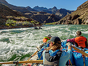 Rowing a raft through whitewater on the last of 16 days boating 226 miles down the Colorado River in Grand Canyon National Park, Arizona, USA. For this photo's licensing options, please inquire at PhotoSeek.com. .