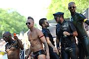 Canal Parade 2013 in de Amsterdamse grachten. De Canal Parade is het hoogtepunt van de Gay Pride, een feestweek met voornamelijk homo's, bi's, lesbiennes en transgenders.<br /> <br /> Canal Parade 2013 in the canals of Amsterdam. The Canal Parade is the highlight of the Gay Pride, a festival week with mostly gay, bisexual, lesbian and transgender people.<br /> <br /> Op de foto / On the photo: <br /> <br />  Al jaren een van de opvallendste boten tijdens de Gay Pride is het vaartuig van leer- en fetisjmerk Mister B. / For years one of the most remarkable boats during the Gay Pride is the craft of leather and fetish brand Mister B.