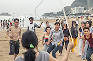 A group of young Vietnamese people jump rope on the beach in Vung Tau, Vietnam, Southeast Asia