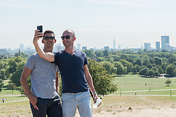 © Licensed to London News Pictures. 24/08/2016. London, UK. People enjoy the sunshine on Primrose Hill as a mini heatwave brings sunshine and predicted temperatures above 30C in the capital. Photo credit : Stephen Chung/LNP