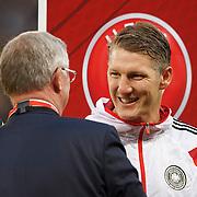 Alex Ferguson (L) meets Bastian Schweinsteiger (C) and Manuel Neuer (R) just before kick off. UEFA EURO 2016 European Championship qualifying round. Scotland v Germany. Hampden Park, Glasgow, Britain.  Final score Scotland 2 Germany 3.  07 Sept 2015
