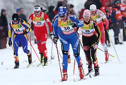 Olga Savialova of Russia (30) and Evi Sachenbacher Stehle of Germany (19) at Ladies` Pursuit 7,5 km Classic + 7,5 km Free at FIS Nordic World Ski Championships Liberec 2008, on February 21, 2009, in Vestec, Liberec, Czech Republic. (Photo by Vid Ponikvar / Sportida)