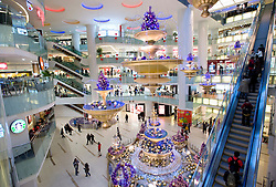 Interior of large new modern shopping mall called Joy City in Xidan district Beijing 2009