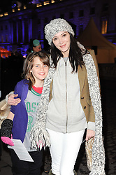 ANNABEL NEILSON and her god daughter POPPY PIERCE daughter of musician Jason Pierce at Skate presented by Tiffany & Co at Somerset House, London on 22nd November 2010.