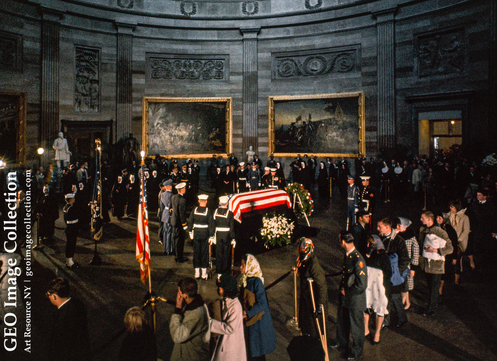 Day and night, November 24, 1963, people file past Kennedy's coffin.