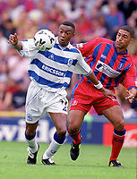 Chris Kiwomya (QPR) and Hayden Mullins (Palace). Crystal Palace v Queens Park Rangers. Football League Division One, 20/08/2000. Credit: Colorsport / Matthew Impey.