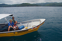 Russell Laman piloting quadcopter drone from a boat while Tim Laman controls the camera.<br /><br />Coiba National Park, Panama