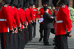 © licensed to London News Pictures.  21/04/2011. Windsor, UK. A soldier faints during preparations for the Royal Wedding by The Irish Guards at Victoria Barracks, Windsor today (21/04/2011). The Commanding Officer Chris Ghika gave a parade of inspection with the Irish Guards Master Tailor Lance Sergeant Matthew Else. Afterwards the Master Tailor measured the guards for their ceremonial dress unifrorms which they will wear on the wedding day. Please see special instructions for usage rates. Photo credit should read Theodore Wood/LNP
