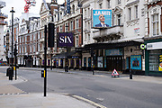 Scene of empty deserted streets on Shaftesbury Avenue with theatres closed as the national coronavirus lockdown three continues on 5th March 2021 in London, United Kingdom. With the roadmap for coming out of the lockdown has been laid out, this nationwide lockdown continues to advise all citizens to follow the message to stay at home, protect the NHS and save lives, and the streets of the capital are quiet and empty of normal numbers of people.