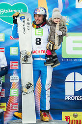 Benjamin Karl of Austria with his child celebrates at flower ceremony after placed third during the Men's Parallel Giant Slalom at FIS World Championships of Snowboard and Freestyle 2015, on January 23, 2015 at the WM Piste in Lachtal, Austria. Photo by Vid Ponikvar / Sportida