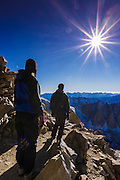 Hikers and sunflair on the Mount Whitney trail, Sequoia National Park, Sierra Nevada Mountains, California USA