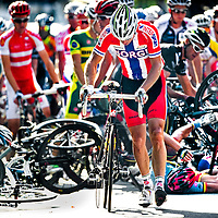 Danmark, Rudersdal, 25-09-2011.<br /> Cycling, World Championships, Men, Elite.<br /> Thor Hushovd from Norway, the former world champion of 2010, walks disillusioned away from the scene after a huge crash on six laps before the finish. <br /> Photo: Klaas Jan van der Weij