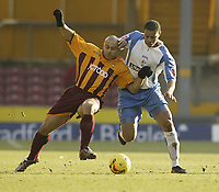 Photo: Aidan Ellis.<br /> Bradford City v Swindon Town. Coca Cola League 1. 11/02/2006.<br /> Swindon's Jarel Ifil and Bradford's Danny Cadamarteri battle for the ball