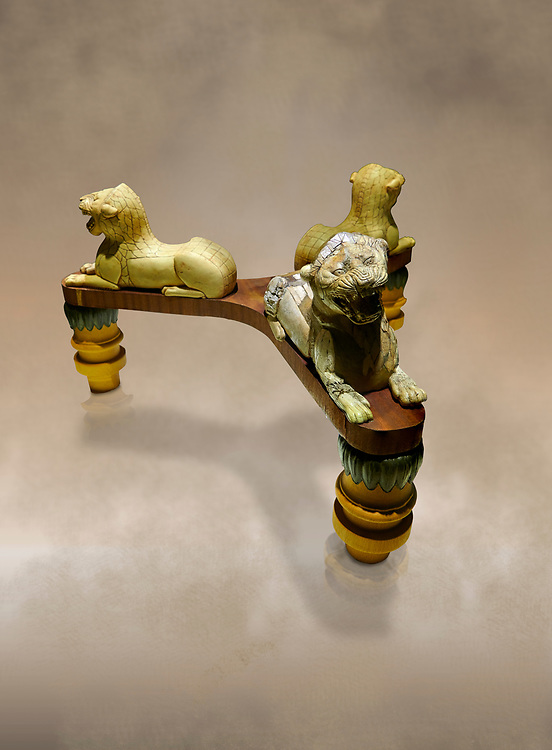 Phrygian table base support decorated with ivory roaring lion statuettes. From Gordion. Phrygian Collection, 8th-7th century BC - Museum of Anatolian Civilisations Ankara. Turkey. Against an art background .<br /> <br /> If you prefer you can also buy from our ALAMY PHOTO LIBRARY  Collection visit : https://www.alamy.com/portfolio/paul-williams-funkystock/phrygian-antiquities.html  - Type into the LOWER SEARCH WITHIN GALLERY box to refine search by adding background colour, place, museum etc<br /> <br /> Visit our CLASSICAL WORLD PHOTO COLLECTIONS for more photos to download or buy as wall art prints https://funkystock.photoshelter.com/gallery-collection/Classical-Era-Historic-Sites-Archaeological-Sites-Pictures-Images/C0000g4bSGiDL9rw