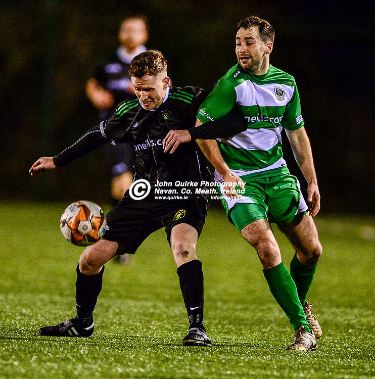 Kentstown Rovers Andy Lynch and Trim Celtic's Brian Faulkner thian they are on 'Dancing with the Stars' as they tussle for the ball     in the Kentstown Rovers v Trim Celtic 'Tully Bookmakers Challenge Cup Final' at MDL grounds, Navan .<br /> <br /> Photo: GERRY SHANAHAN-WWW.QUIRKE.IE<br /> <br /> 07-12-2019